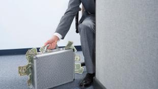 Businessman with briefcase money