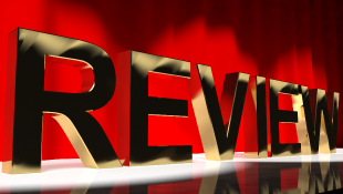 Review in gold 3d text on red background