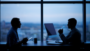 Two businessmen working late in office