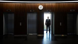 Person in elevator doorway dark room