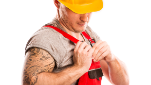 Construction worker pinning something to uniform