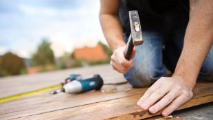 Contractor hammering floor