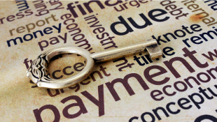 Key lying on payment text