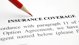 Red pencil on Insurance coverage document