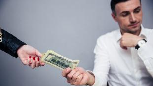 Businessman handing someone money