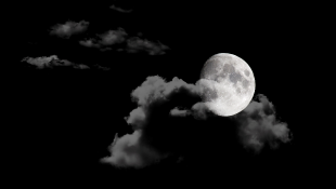 Moon and clouds on black sky