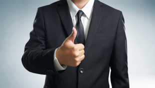 Businessman holding thumb up
