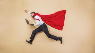 Businessman in superhero flying pose