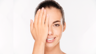 Woman holding hand over half of her face