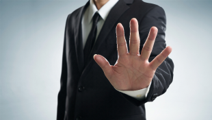 Businessman holding hand up