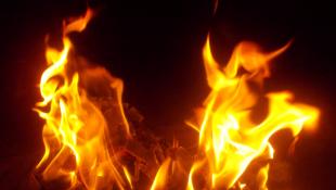 Flames over black background