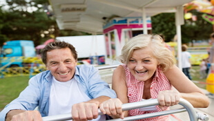 Senior Couple at Amusement Park