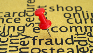 Red pin on the word fraud
