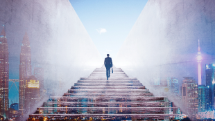 Businessman climbing stairs with city behind image