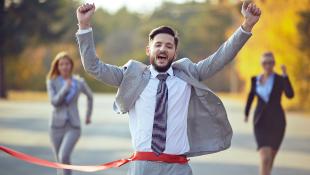 Businessman crossing finish line