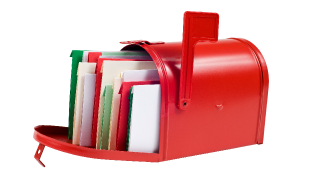 Red mailbox stuffed with colorful cards