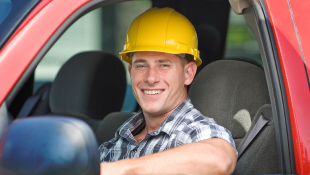 Construction worker smiling in vehicle