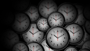 Many clocks with faded black background