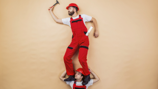 Construction workers in funny pose showing unsafe practices