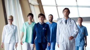 Doctor team walking in modern hospital corridor