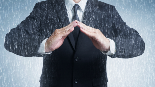 Businessman with hands in arc