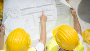Two construction workers looking at plans