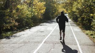 Runner on park road