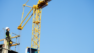 Crane over dark blue sky