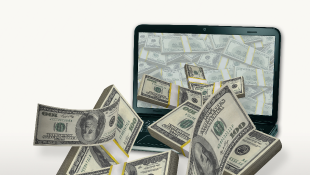 Money bills coming out of computer