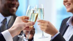 Business partners toasting with champagne