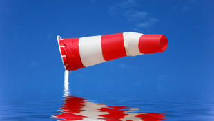 Construction cone flying in wind over water