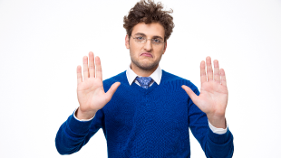 Businessman with hands up in stop gesture