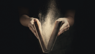 Opening old book dust rises