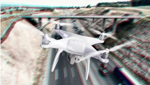 Drone flying over bridge
