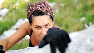 Woman climbing mountain