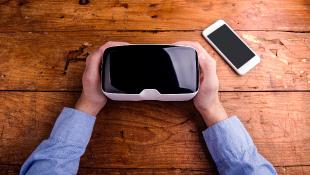 Someone holding VR glasses