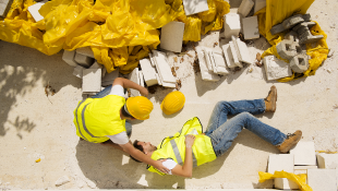 Construction worker lying injured