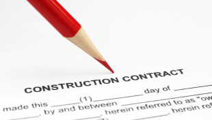 Red pencil leaning on construction contract