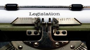 Typewriter with paper saying Legislation