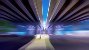 Blurred view of driving along bridge