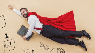 Businessman in superhero cape in flying pose