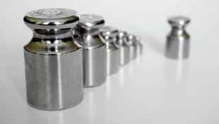 Silver chess pieces in a row