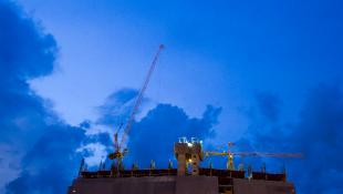 Crane against dark blue sky